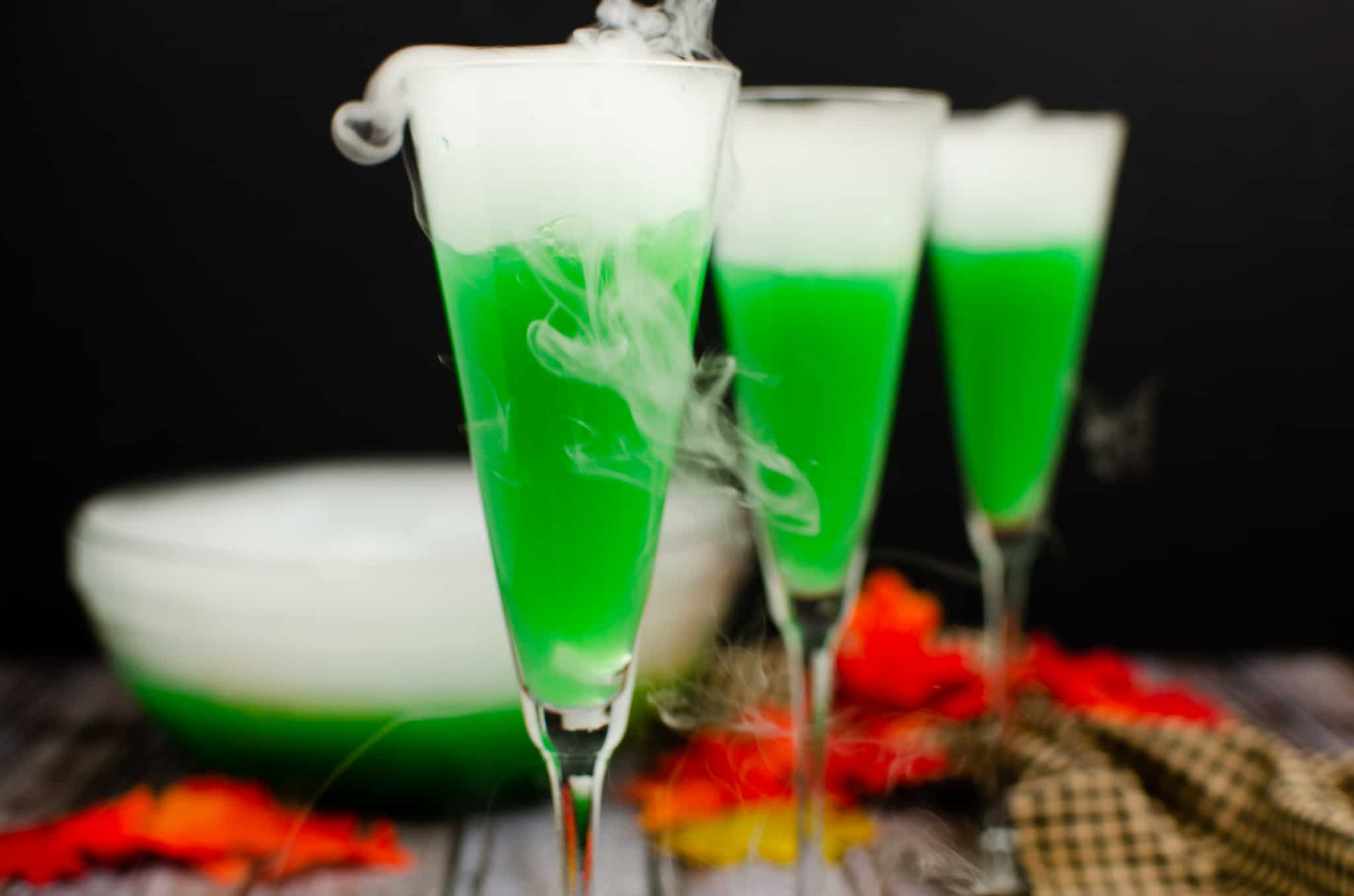 green cocktail with dry ice