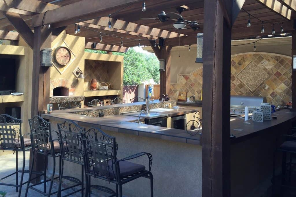 Take your outdoor kitchen bar from ho-hum to outstanding! These must-have pieces will keep the party rolling and let you enjoy more time with your guests.